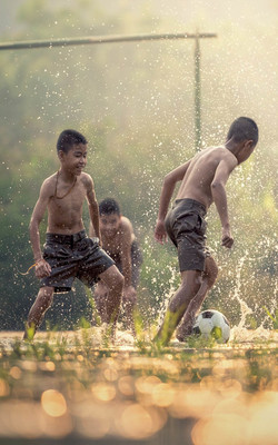 Asian Kids Playing Soccer Mobile Wallpaper Preview