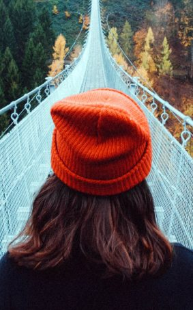 Girl Crossing Mountain Bridge HD Mobile Wallpaper