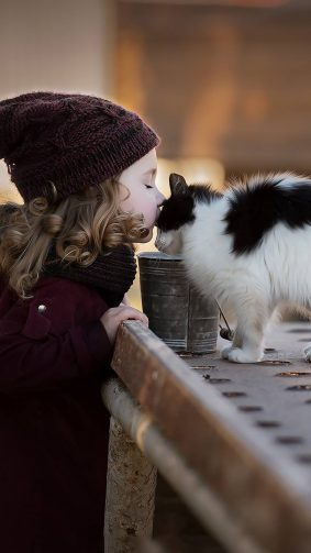 Adorable Girl Child Kissing Cat 4K Ultra HD Mobile Wallpaper