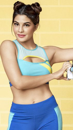 Jacqueline Fernandez Photoshoot Yellow Background 4K Ultra HD Mobile Wallpaper