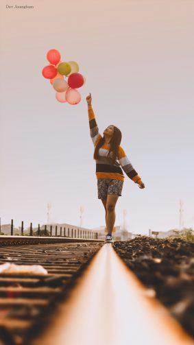 Happy Girl Balloons Train Track Photography 4K Ultra HD Mobile Wallpaper