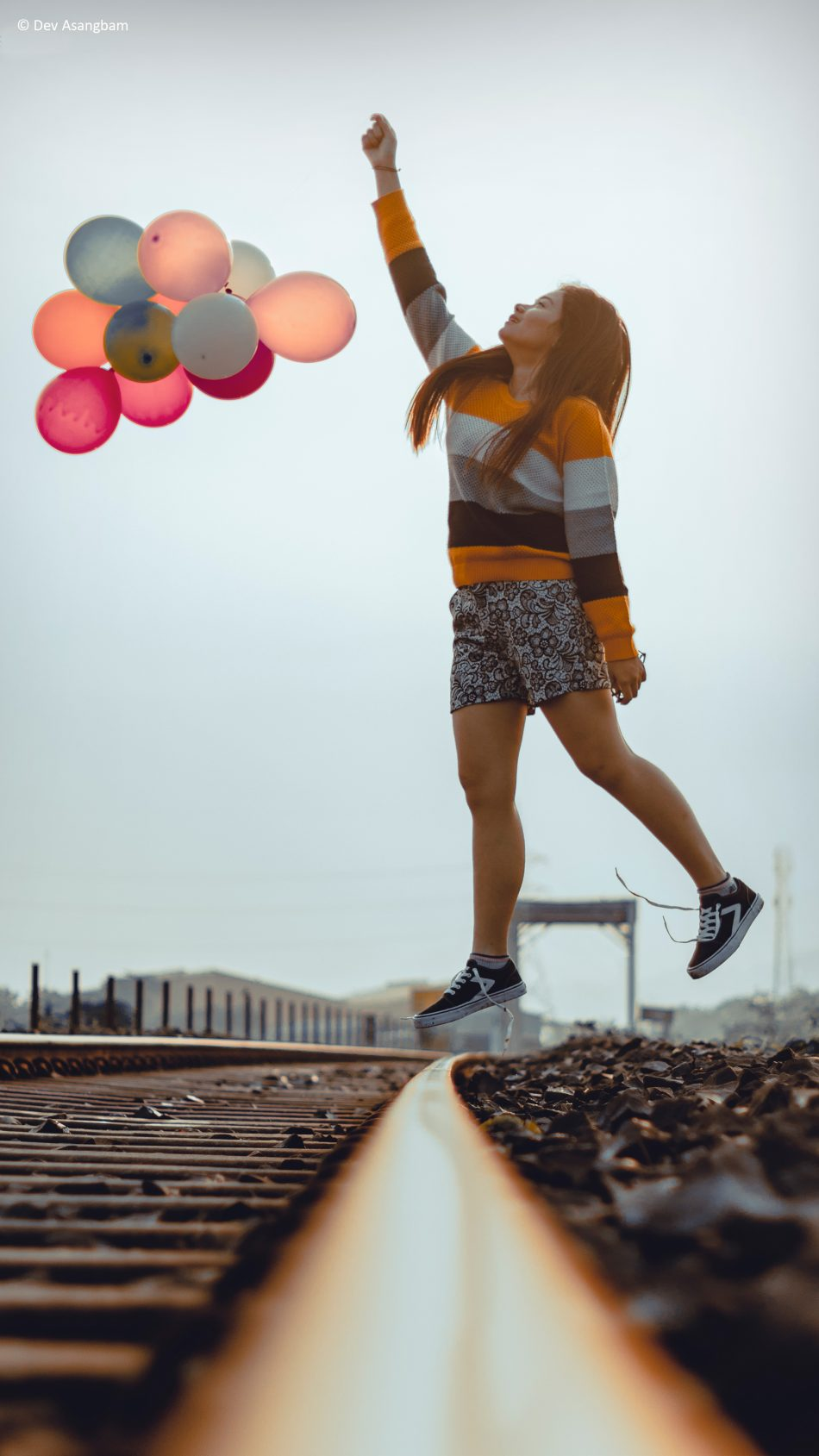 Happy Girl Jumping Balloons Train Track Photography 4K Ultra HD Mobile Wallpaper