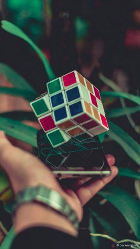 Hand Phone Rubik's Cube Leaves 4K Ultra HD Mobile Wallpaper
