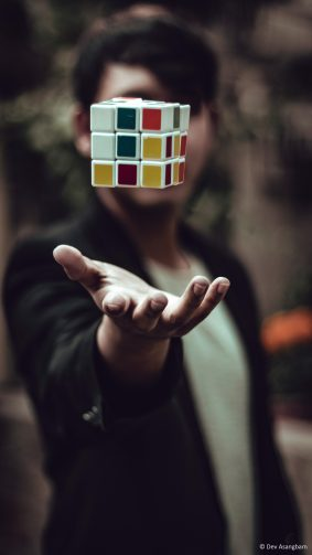 Man Rubik's Cube In Air 4K Ultra HD Mobile Wallpaper