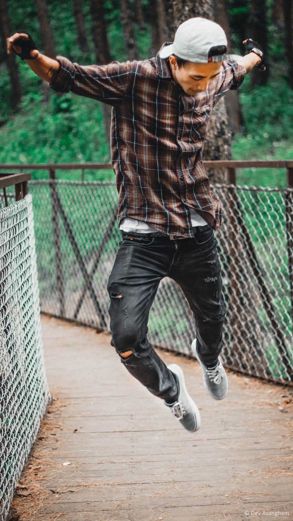 Man Cap Sneakers Jumping Photography 4K Ultra HD Mobile Wallpaper