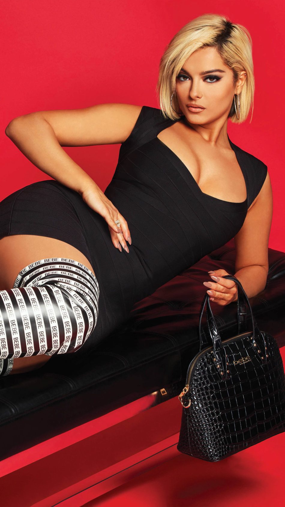 Bebe Rexha Black Dress Red Background 4K Ultra HD Mobile Wallpaper